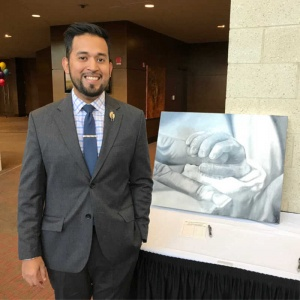 2018 Benefit, Juan Enrique Velazquez with artwork he donated to the auction.