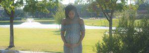 Pregnant mama looking down at a park